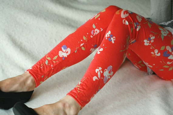 Red leggings with floral ornaments