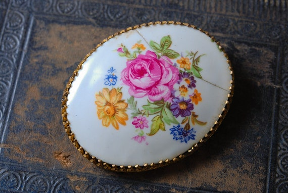 Vintage gold plated brooch, with porcelain cabochon