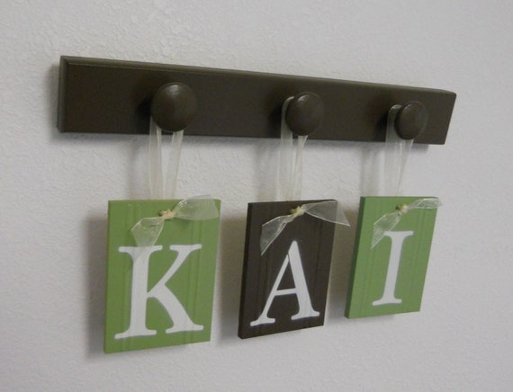 Wooden Letter Wall Alphabet Nursery Decor - KAI Set Includes 3 Wood Pegs in Brown and Light Green
