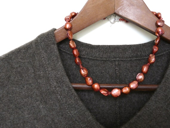 BURNISH. metallic coral red keishi pearl necklace with rich orange red burgundy and sterling silver clasp