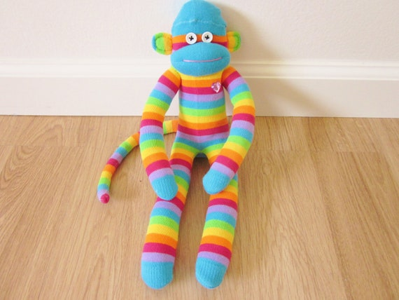 Rainbow sock monkey plush doll with blue accents and rhinestone heart