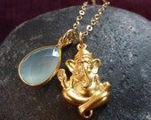 Ganesh. 24k gold plated Ganesh with teardrop shaped aqua chalcedony