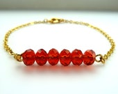 Ruby red bracelet on gold plated chain, Swarovski siam faceted crystal bead, pomegranate seeds delicate feminine