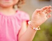 Pink and Orange Girls Stretch Bracelet with Orange Flowers, GB 105