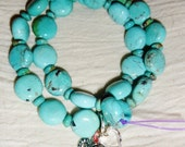 Natural turquoise wrap bracelet with two heart charms