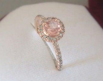 Natural  0.5 carat peach sapphire.Cyelon,Diamond gold Ring.