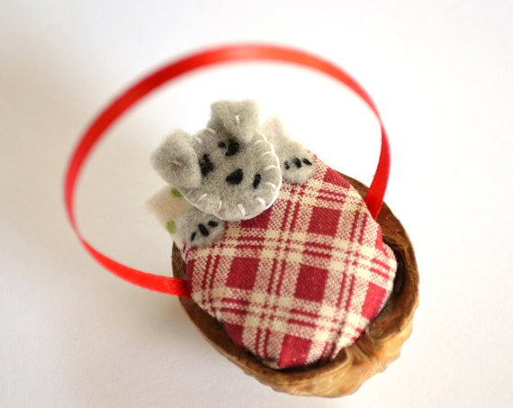 Snuggle Schnauzer in a Nut Shell Christmas ornament