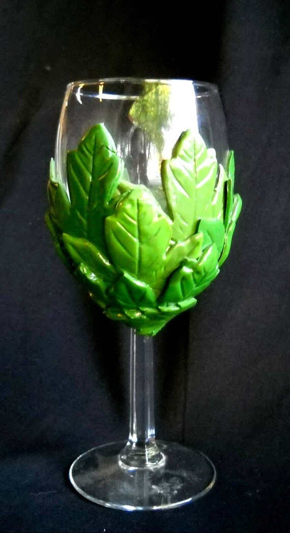 Summer leaves decorate a wine goblet