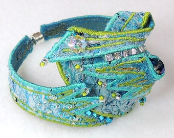 Textile cuff bracelet in turquoise, blue and green