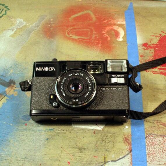 Vintage Minolta Hi-Matic AF 2 Camera with Case and Manual