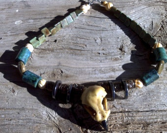 2 inch resin eagle skull,turquoise,porcelan,bone,hematite,beaded necklace  20 inch