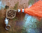 Moroccan art silk tassel - large filigree wood cut out - moroccan ornament - orange - silver tone beads