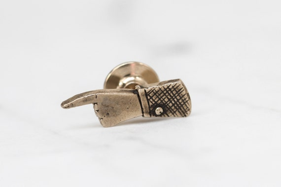 Pointing hand brass lapel pin