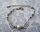 White Pearl Bracelet with Wings