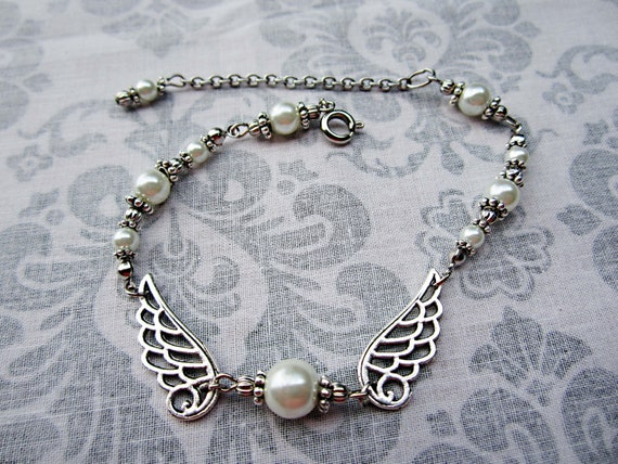 RESERVED M. CAHILL White Pearl Bracelet with Wings