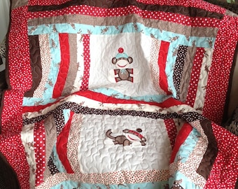 Blue, red, brown, and cream boy sock monkey baby quilt approx. 50x58