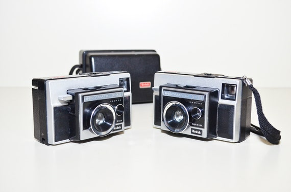 Two Kodak Instamatic X-35 Cameras