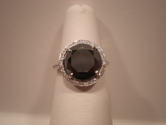 4-Carat Black Diamond Ring surrounded by a halo of white diamonds set in 14K white gold