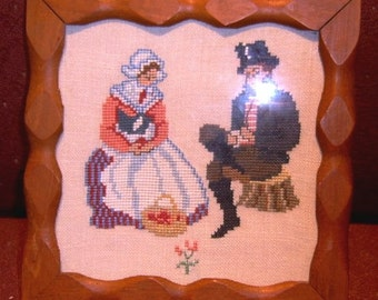 Needlepoint Cross Stitch Sitting Courting Couple in Hand made Frame.