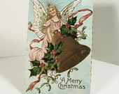Antique Greeting Postcard 1910 - A merry Christmas - Holly - Angel
