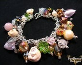 Voodoo Love Charm Bracelet- Pink rose quartz, amber lampwork and faceted crystal beads.