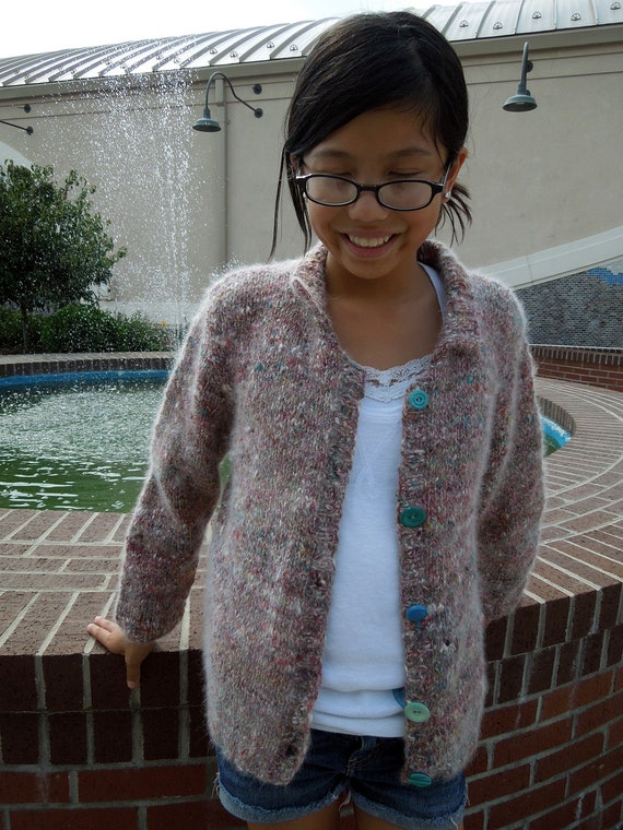 Noro Handknit Sweater is knit from a luxurious blend of wool and angora.