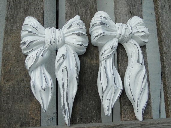 Girly Home Decor Updated Wall Decor vintage bow plaques in distressed white over gray for vintage nursery