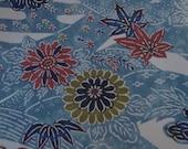 Blue, cream and colours on kimono  silk.