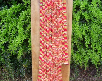 Hand knitted by liz Lacy frilly scarf in red orange yellow & shades in 100% alpaca