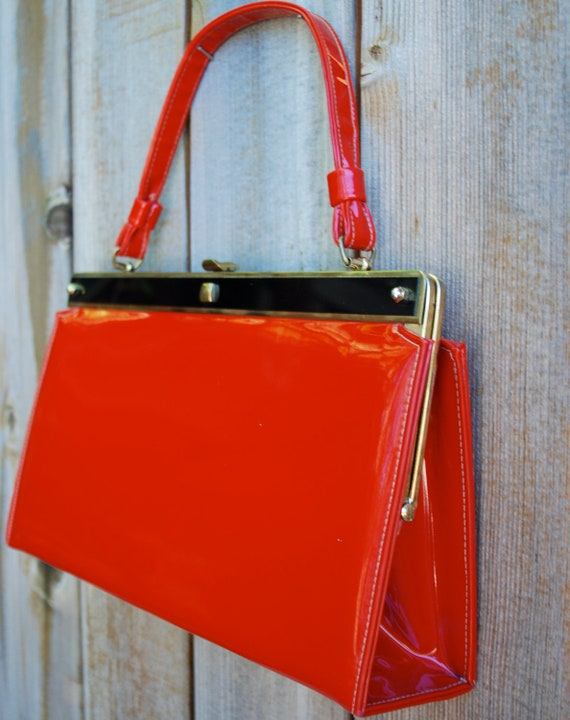 Women's vintage purse, red patent leather clutch with black and gold hardware by Sears.