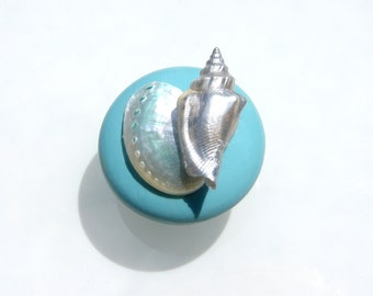 Cabinet Knobs in Cadillac Blue with silver seashells and abalone shell.