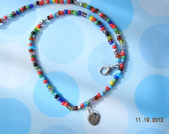 Three Crosses handcrafted in Fine Silver dropped from a Unique Beaded Multi-Colored Glass Chain, All handcrafted by Two Artists, OOAK