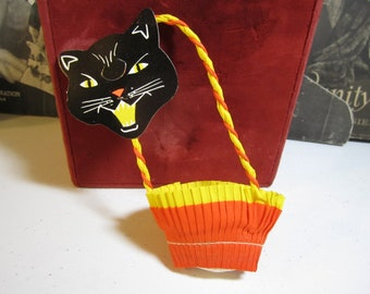 1950's-60's unused crepe paper Halloween party nut or candy cup party favor with die cut hissing black cat face