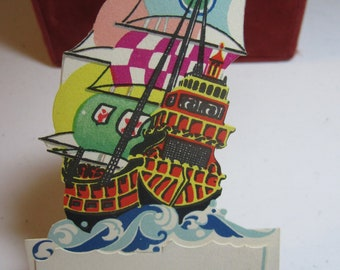 Vintage 1920's Art Deco unused die cut P.F. Volland Novelty bridge tally card colorful ship on the ocean with place card attached and poem