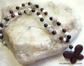 Brown butterfly necklace, brown, black and white beads with argentium sterling silver love knots