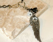 Angel wing necklace, silver pendant with glass bell flowers, feather necklace
