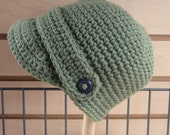 Dark sage green newsboy style hat with button strap