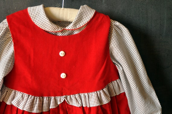 Two piece set, red corduroy dress, with puppy, and matching black and white polka dotted shirt, size 4T