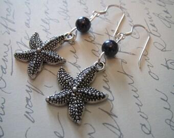 Silver Starfish earrings with dark purple pearls
