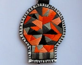 Skull ornament with geometric design embroidered with black leather for Halloween or Day of the Dead
