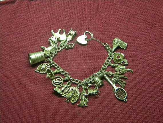 Vintage Sterling Charm Bracelet with 18 Sterling Charms