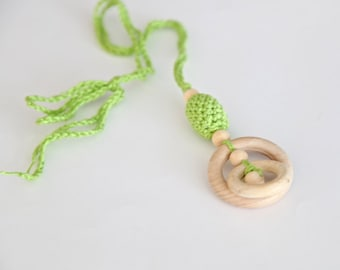 One lime green teething rings nursing necklace with wooden olive, green teething toy.