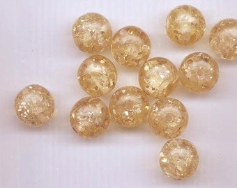 Twelve beautiful vintage lucite beads -17 mm rounds - light golden beige with lots of sparkle