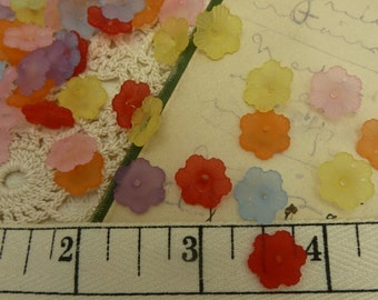 30 lucite flower beads in a mix of colors  size 12 mm x 4 mm