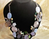 Necklace in semiprecious stones like pink quarz, agate, chalcedony shell and glass beads.