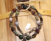 Chinese writing stone pendant on mixed jasper and silver necklace in greens and browns