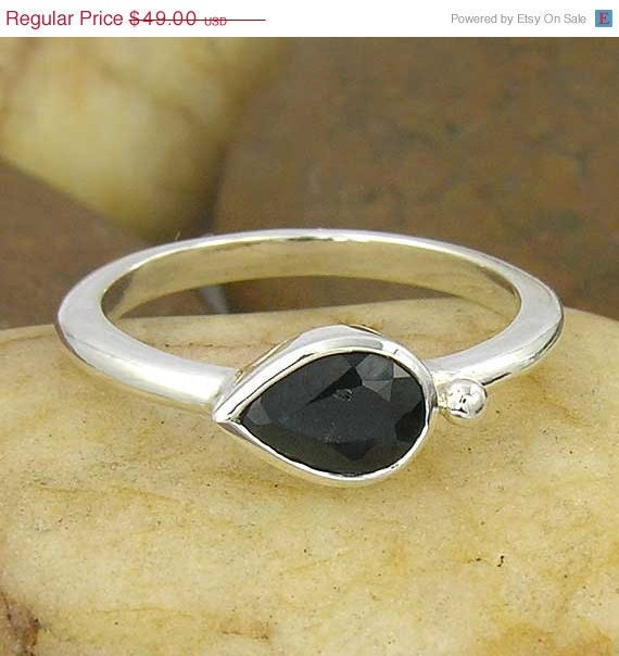 Pear shape black sapphire east to west setting with silver bear sterling silver ring