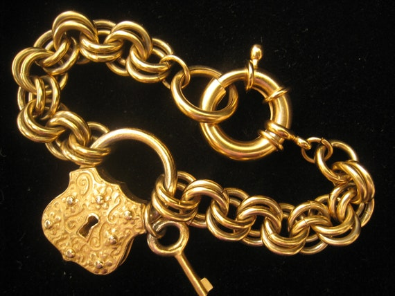 Vintage Heavy Double Link Charm Bracelet wih Lock and Key Charms in front and Huge Spring Loaded Clasp All in Vibrant Matte Gold Finish