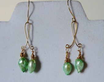 Freshwater blister pearls in a very pretty pale blue/green color.  wire wrapped, hand made ear wires.