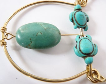 Stunning pendant of turquoise oval stone and turtle festishes carved out of turquoise colored howlite, amazonite chips, Native, soho,